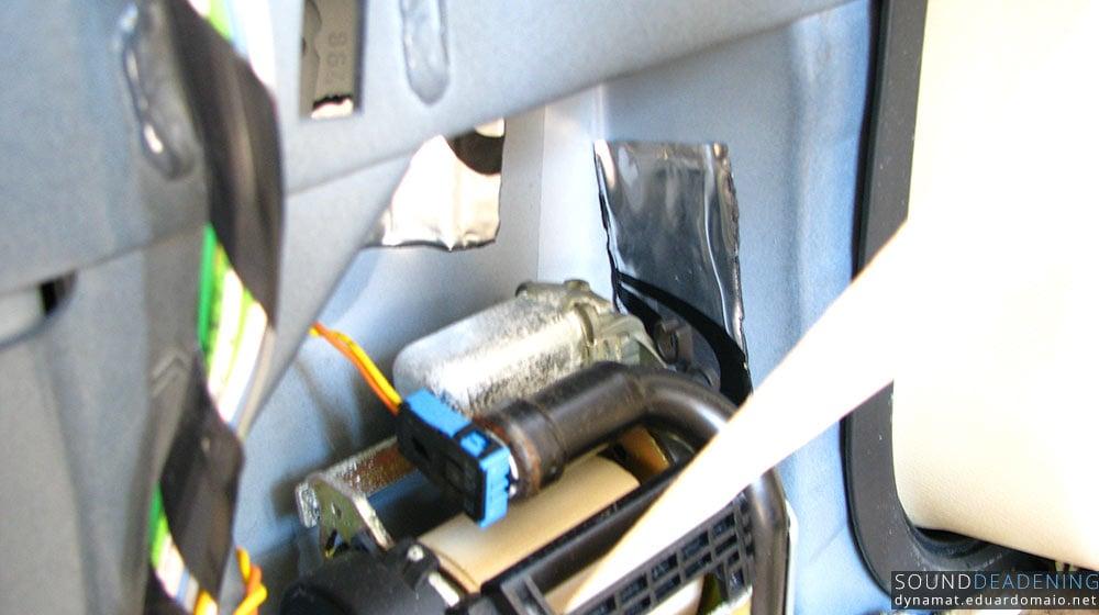 Dynamat Extreme near the seat belt roller